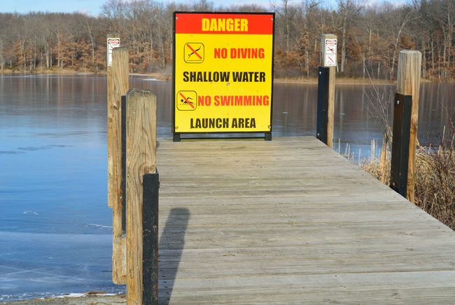 Boat Dock Boat Landing Danger Sign Danger Signs Danger Zone Danger! Day Information Information Sign Launch Area No Diving No People No Swimming Outdoors Park Parks Shallow Water Shallow Water Beach Sand Abstact Nature Patterns In Sand What Is That? What Is It? Water Ripples Ocean Backgrounds Patterns Beach Serene Sign Sign, Sign, Everywhere A Sign Signage Signboard Signs SignSignEverywhereASign Water