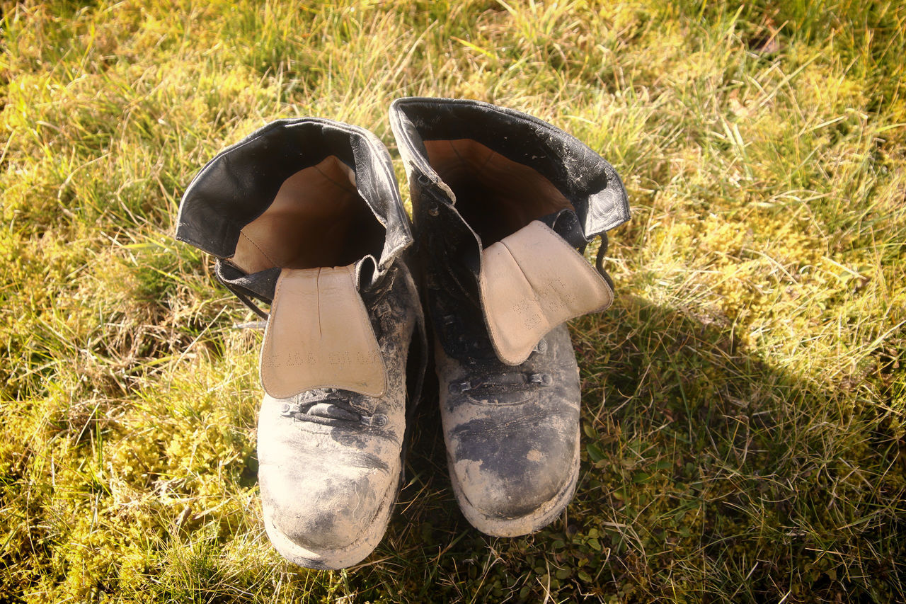 Old shoes Adult Adults Only Day Field Grass Human Body Part Lifestyles Low Section Men Nature Old Shoes One Man Only One Person Outdoors People Shoes