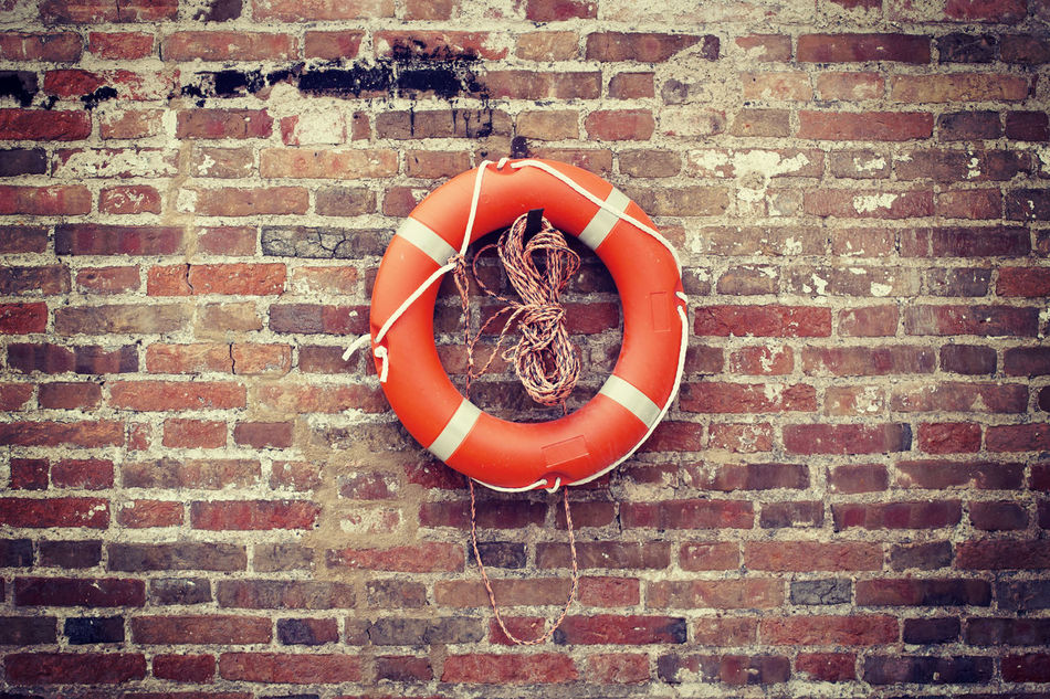 life-saver hanging on a brick wall outdoors ready to use Belt  Brick Wall Circle Close-up Emergency Equipment Hanging Life-saver Lifebelt Nautical No People Object Red Riverside Rope Rubber Safeguard Safety Security Sos Swimming