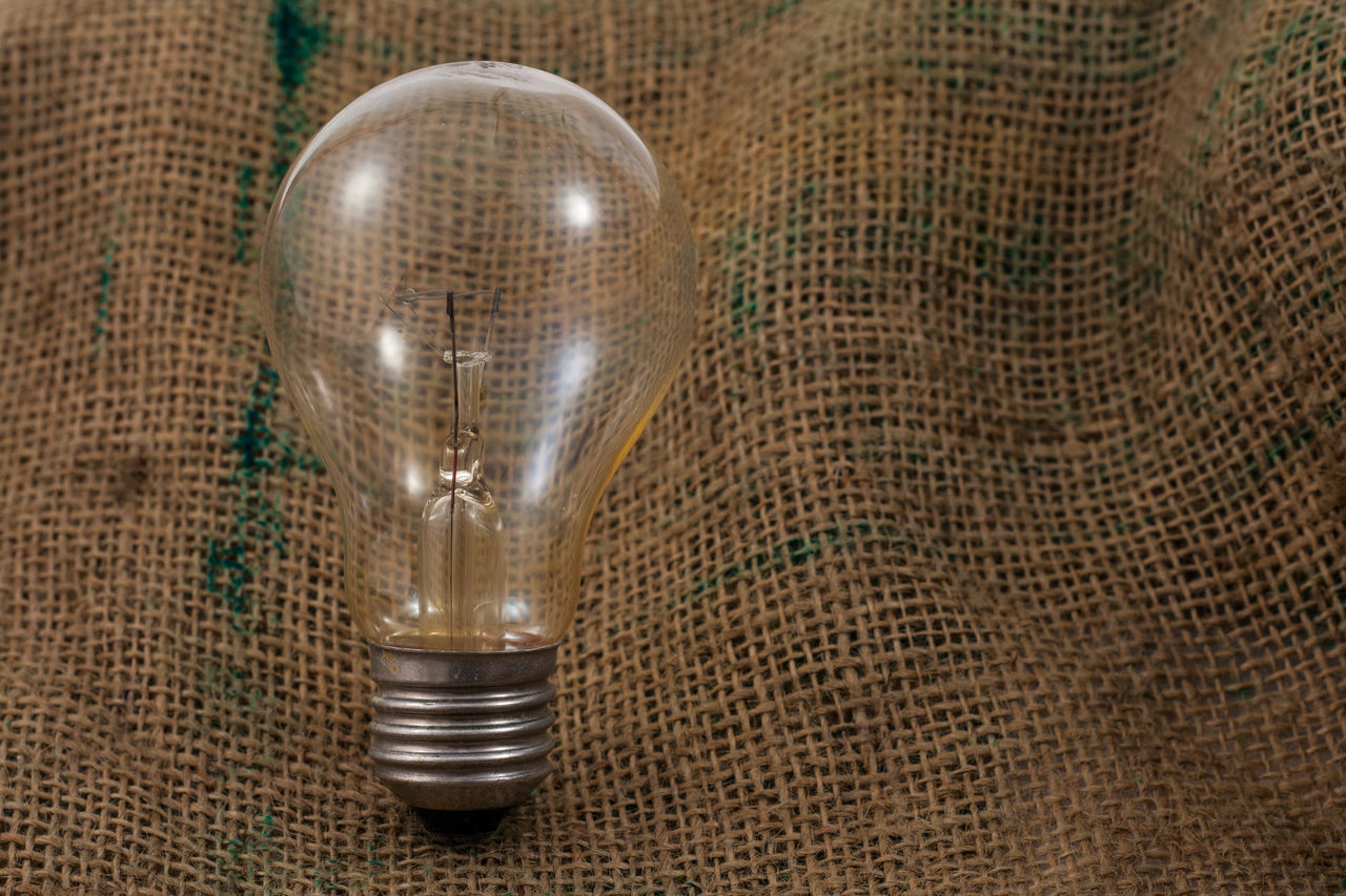 Bulb light on the Sackcloth Bulb Conceptual Eletric Glass Isolated Light Mentol Sackcloth Still Life