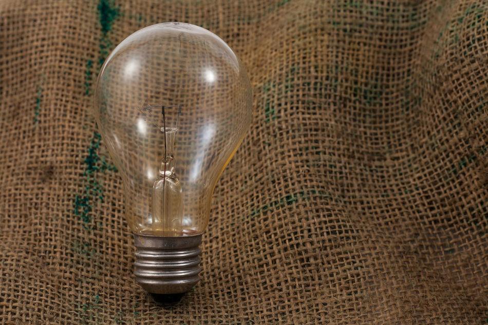 Bulb light on the Sackcloth Bulb Conceptual Eletric Glass Isolated Light Mentol Sackcloth Still Life