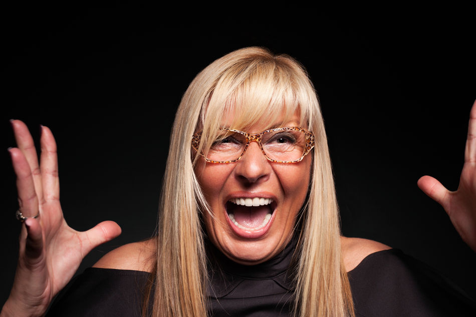 Mature woman screaming hysterically Black Background Blond Hair Blonde Business Business Finance And Industry Competition Control Eyeglasses  Glasses Lady Mature Adult Mature Women Middle-aged One Person Panic People Person Scream Shock Stress Studio Shot Suprise Woman Woman Portrait Work