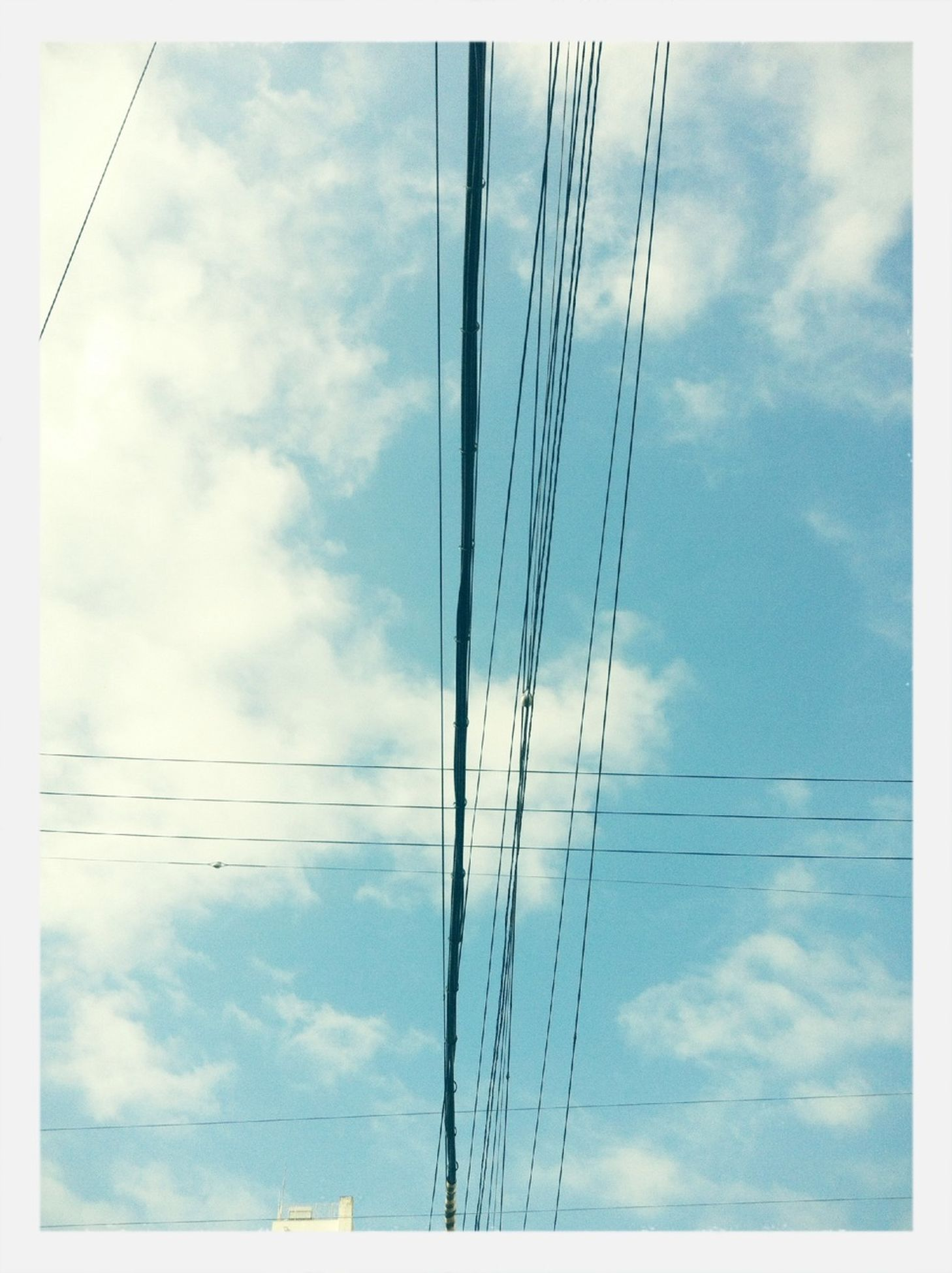 sky, low angle view, cloud - sky, cloudy, cloud, power line, blue, cable, transfer print, power supply, connection, pole, electricity pylon, electricity, day, auto post production filter, no people, outdoors, fuel and power generation, technology