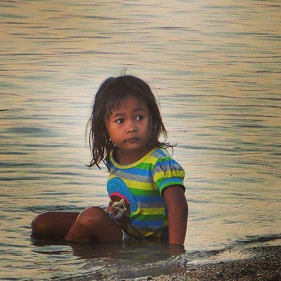 Little balinese girl chilling on the beach Bali Children Ilovebali ILoveAsia Balibible Balilove Travel Kids
