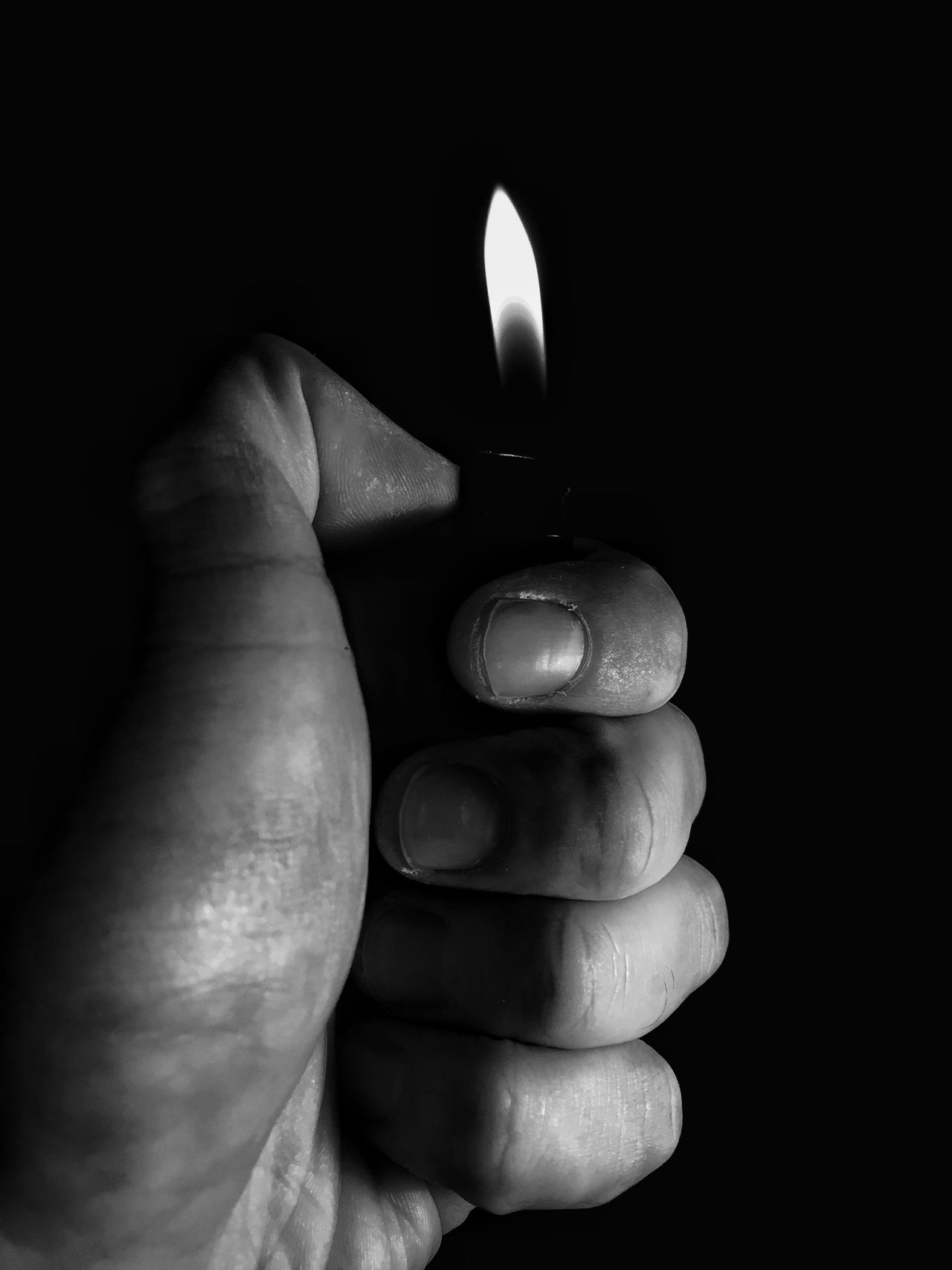 Light reflection Lighter Flame Reflection Light Shadows & Lights Hand Fingers Human Hand Human Body Part Burning Flame One Person Close-up Holding Indoors  Black Background