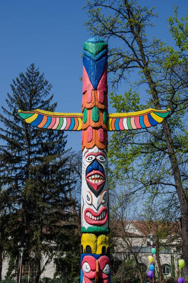 Art Blue Day Face Indians  Low Angle View Multi Colored Outdoors Totem Totem Pole Tree