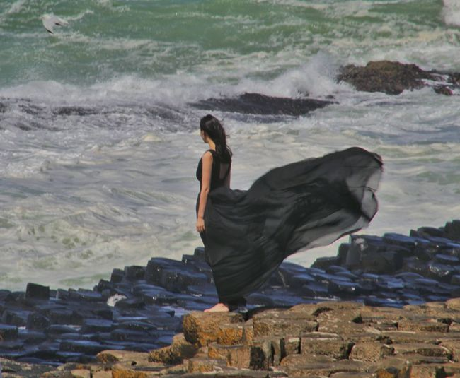 Giants Causeway Northern Ireland Best Of EyeEm Girl On The Rocks Windy Day EyeEm Gallery EyeEm Best Shots Exceptional Photographs Natures Magic Windy Black Dress Wind Blowing Girls Dress Girl In Black Dress Barefoot On The Rocks Atlantic Coast North Coast Of Ireland Waves And Rocks Our Best Pics Natural Phenomenon Strange Rock Formations Famous Landmarks World Heritage Rocks The Magic Mission People And Places