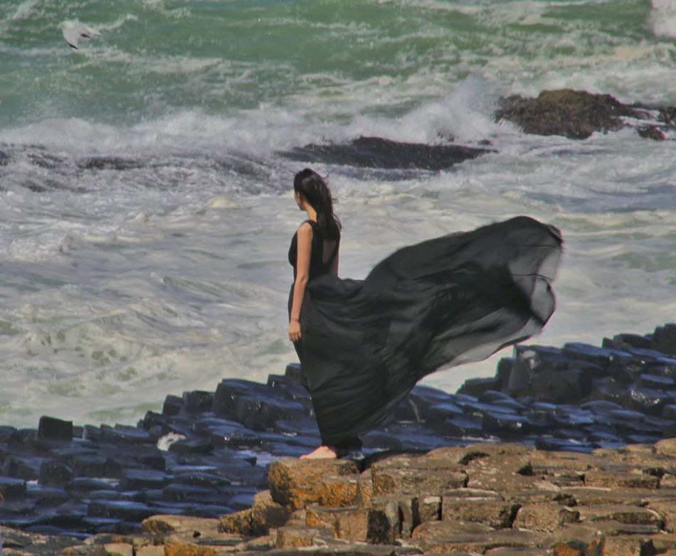 Giants Causeway Northern Ireland Best Of EyeEm Girl On The Rocks Windy Day EyeEm Gallery EyeEm Best Shots Exceptional Photographs Natures Magic Windy Black Dress Wind Blowing Girls Dress Girl In Black Dress Barefoot On The Rocks Atlantic Coast North Coast Of Ireland Waves And Rocks Our Best Pics Natural Phenomenon Strange Rock Formations Famous Landmarks World Heritage Rocks People People And Places