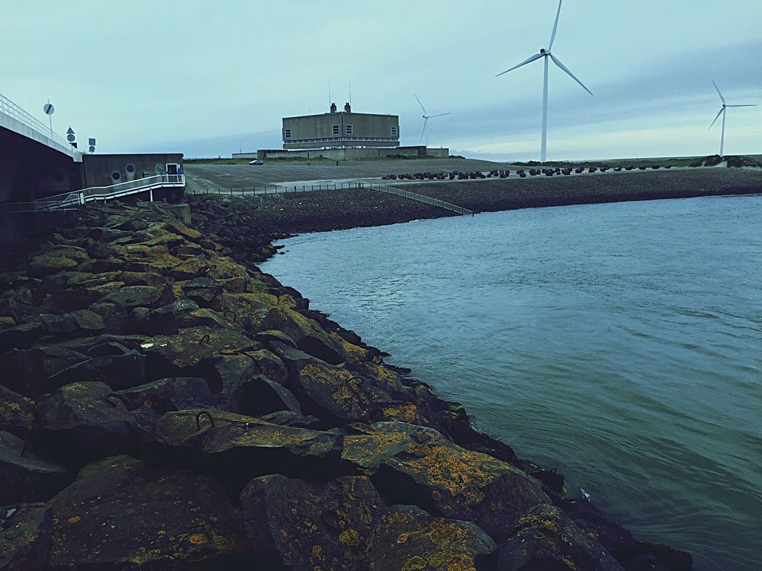 This was a picture I took in Europe at the Dikes in Holland! 👍 Sea Wind Turbine Water Scenics Day First Eyeem Photo