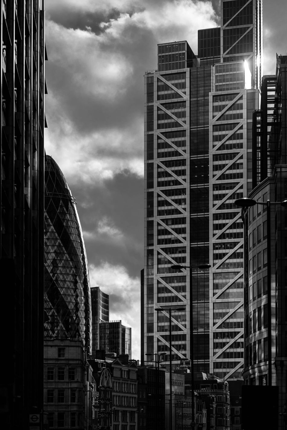 The Gherkin and other imposing buildings from the heart of the city just taken outside Liverpool Street station. Strong sunlight causes the Gherkin to glimmer. Moody clouds. Cityscapes Monochrome Travel Sky London Blackandwhite Moody Sky Urban City Architecture Moody Clouds
