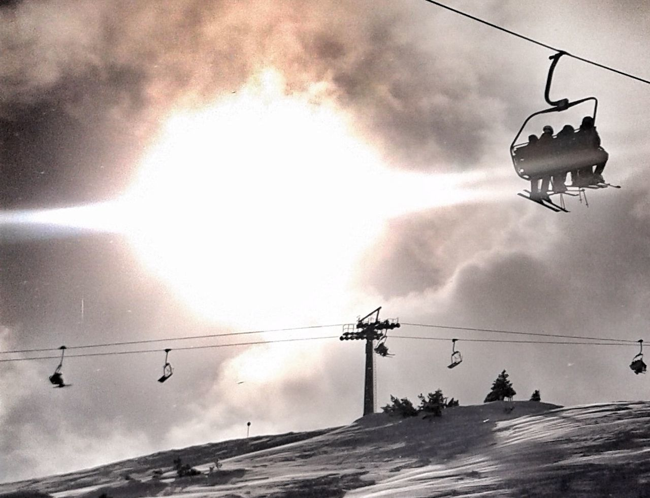 cable, sky, hanging, low angle view, outdoors, silhouette, nature, no people, day, cloud - sky, sunset, overhead cable car, flying, bird, animal themes, building exterior, architecture, ski lift