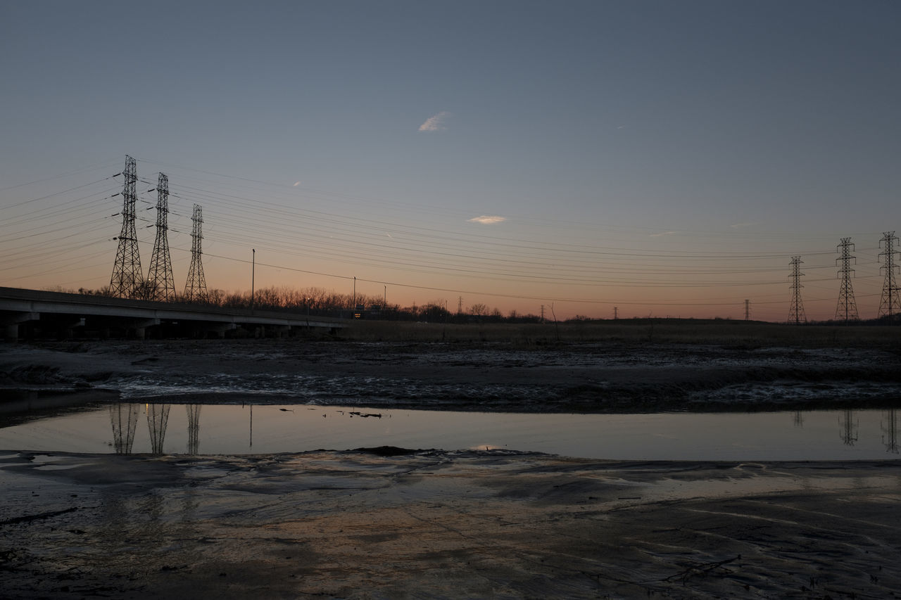 sunset at the marsh Beauty In Nature Electricity  Electricity Pylon Nature No People Outdoors Sky Sunset Tranquility Water Premium Premium Collection