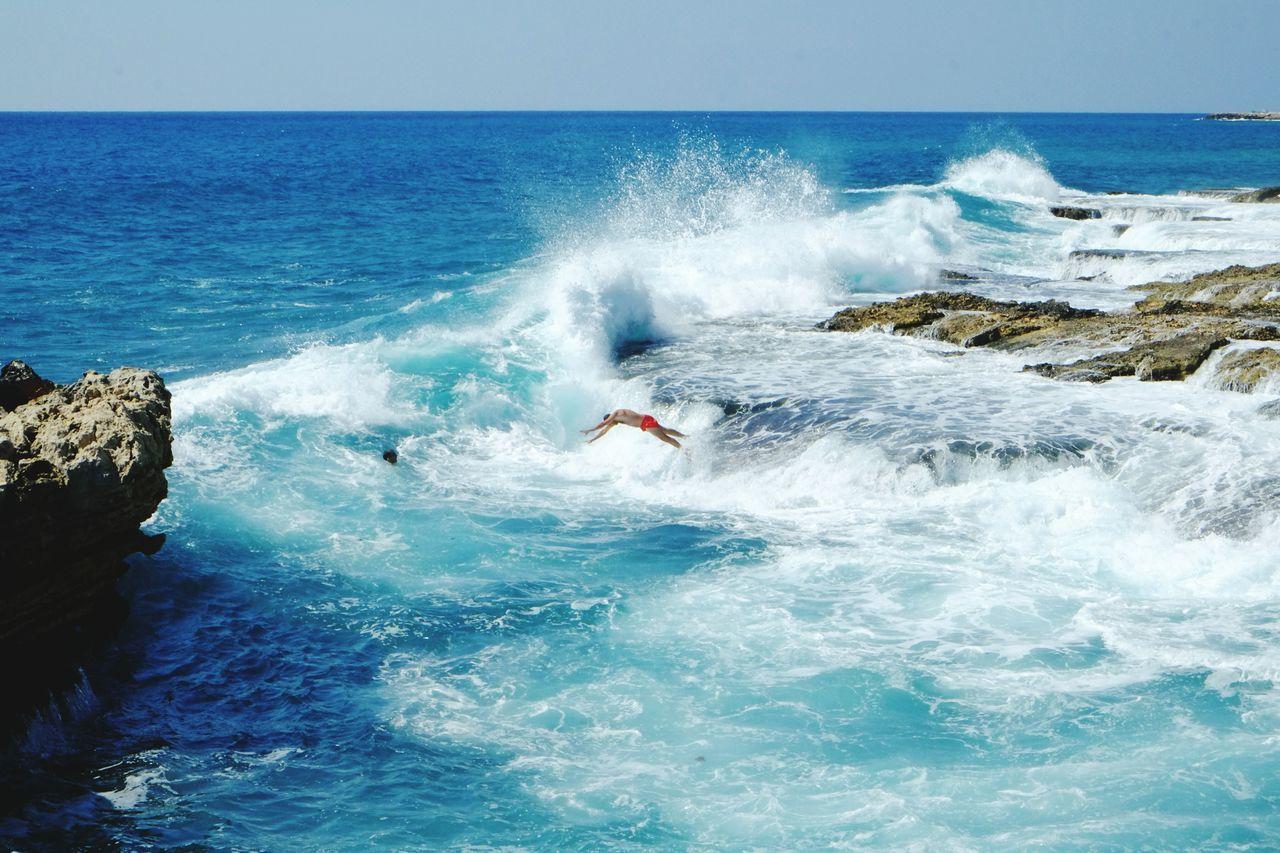 Waves Splashing Against Rocks At Seaside