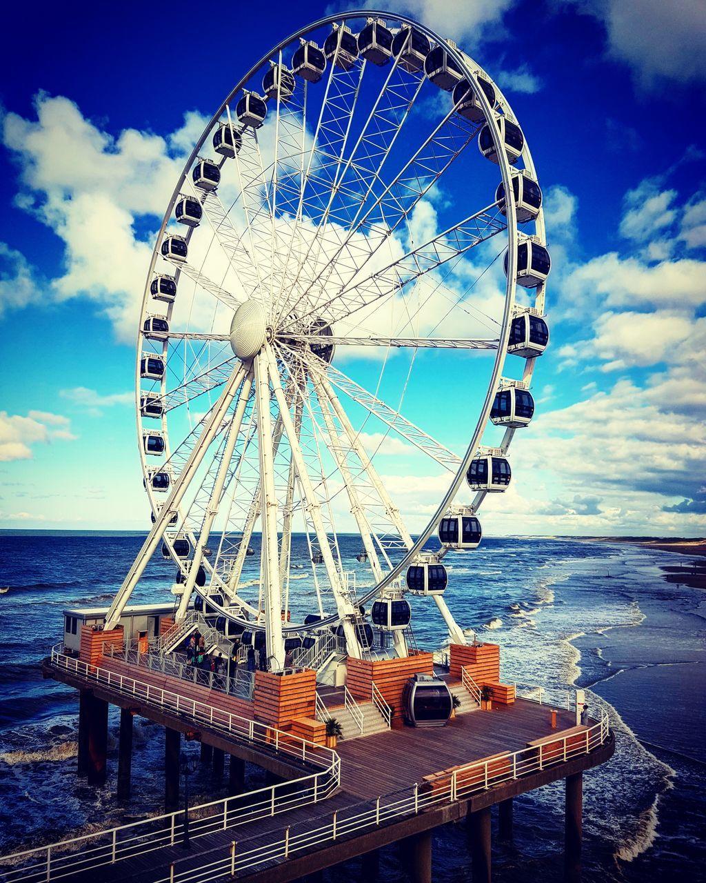 sea, sky, water, cloud - sky, ferris wheel, horizon over water, outdoors, day, no people, big wheel, blue, nautical vessel, nature, close-up