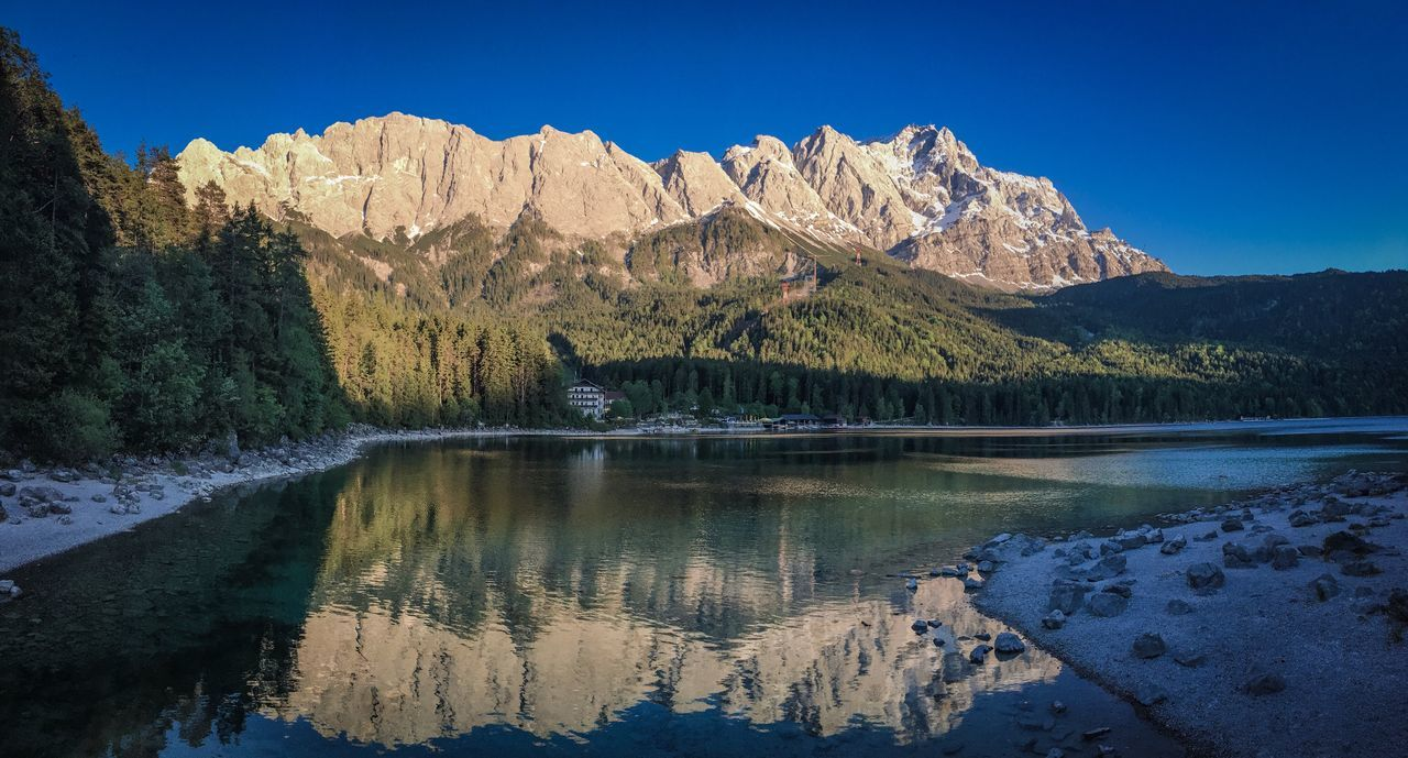 The Great Outdoors - 2017 EyeEm Awards Mountain Beauty In Nature Scenics Tranquil Scene Reflection Lake Mountain Range Nature Tranquility Water Idyllic Majestic Tree No People Outdoors Clear Sky Snow Landscape Sky Rocky Mountains Zugspitze Eibsee Bayern Bavaria