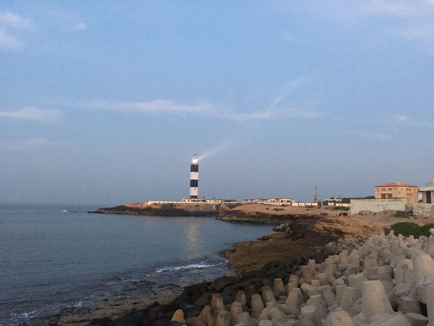 Lighthouse at edge of land mass