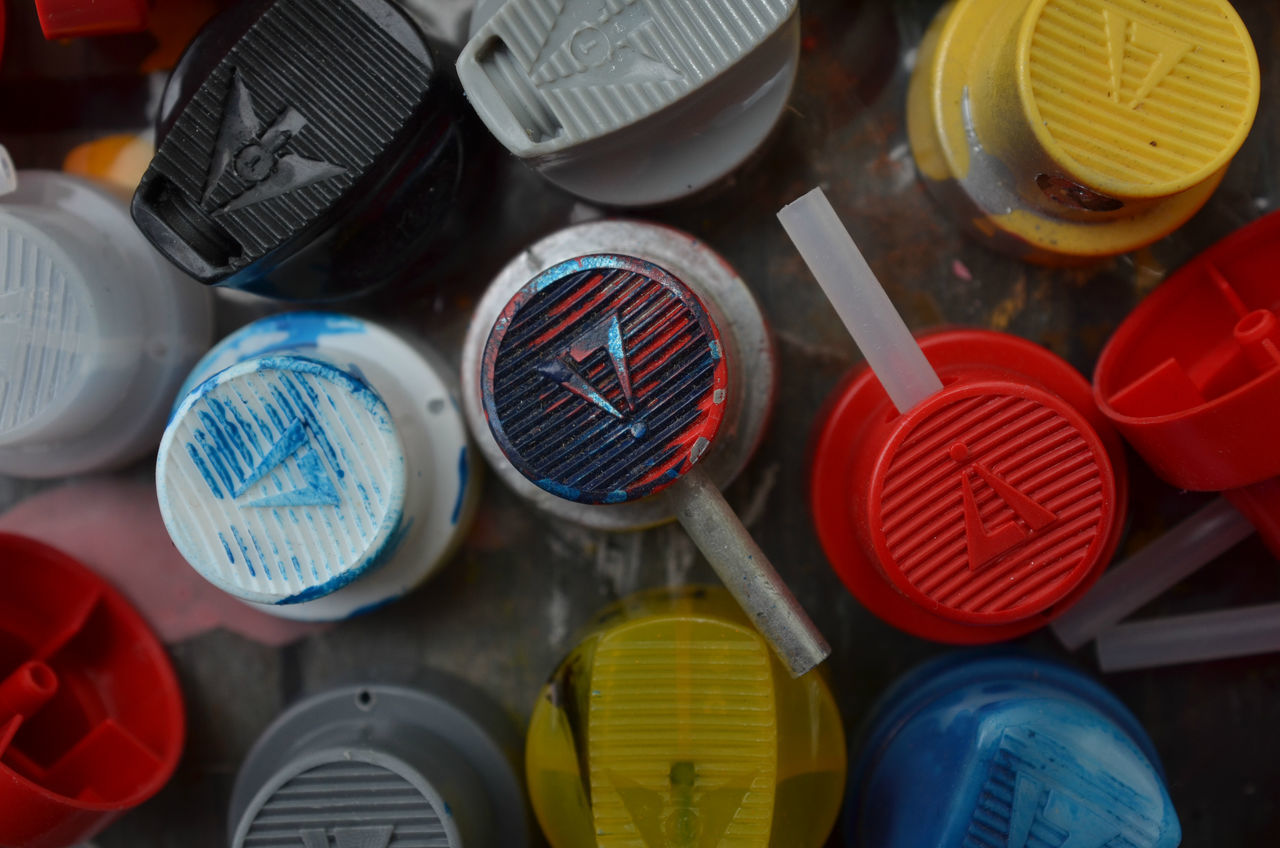 cans of spray paint and caps Aerosol Blue Paint Cans Caps Close-up Day Graffiti Multicolors  No People Red Paint Spray Cans Spray Paint