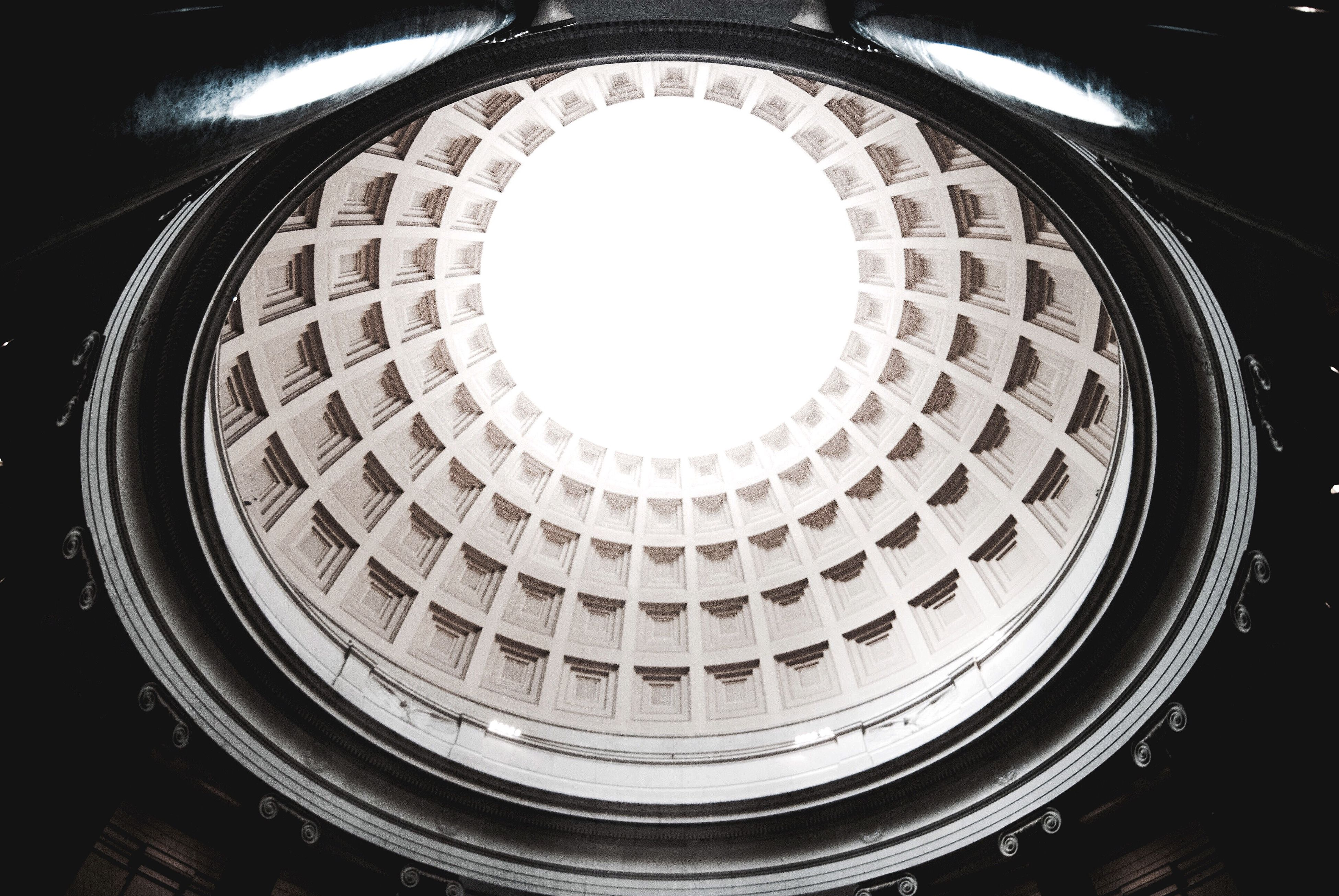architecture, built structure, low angle view, architectural feature, circle, geometric shape, ceiling, skylight, directly below, indoors, design, building exterior, sky, repetition, day, dome, architectural design, modern, concentric, curve, architecture and art, creativity, building story, famous place, cupola, circular, no people
