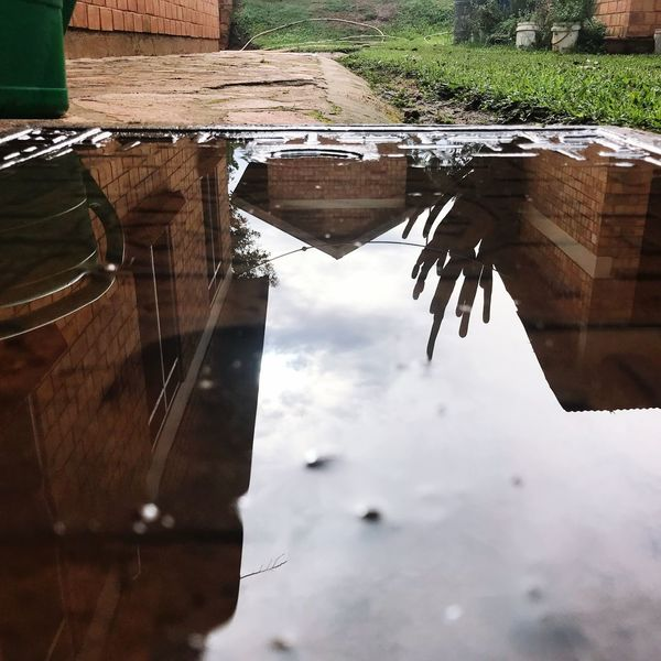 Sky Day Reflection Water No People Outdoors Puddle Close-up Manhole Cover Architecture Metal Reflections