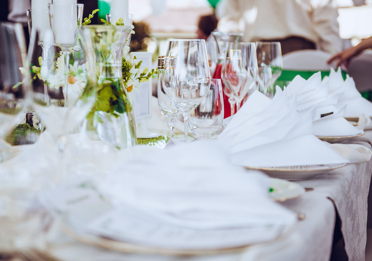 Wedding table. Close-up of folded napkin and empty glasses Banquet Crockery Dinner Dishware Elegant Engagement Napkins Table Setting Wedding Wedding reception close-up glass glassware indoors no people nobody party place setting restaurant selective focus table table appointments tablecloth Wedding wineglass