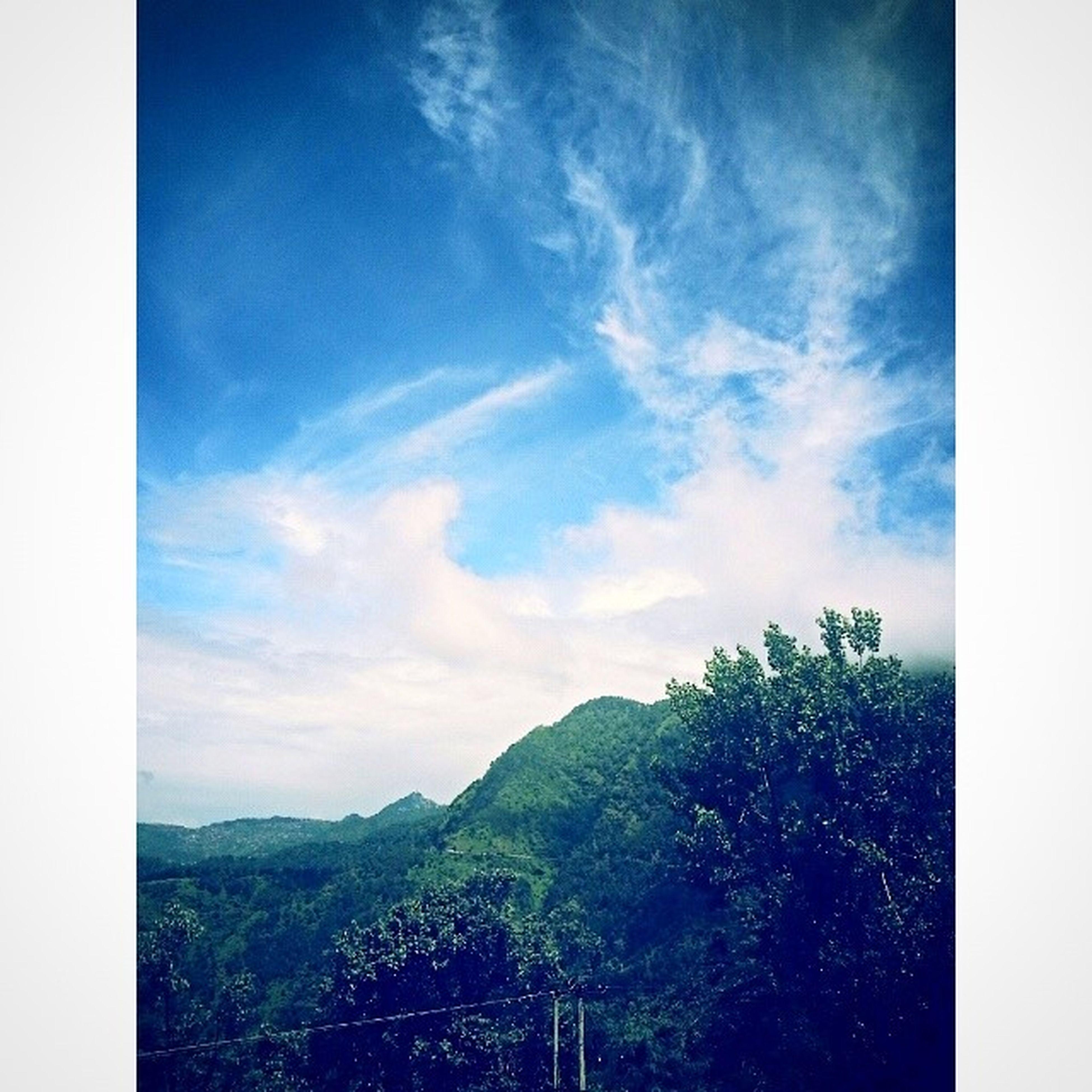 transfer print, auto post production filter, sky, mountain, tranquil scene, scenics, tranquility, tree, beauty in nature, landscape, nature, cloud, cloud - sky, blue, mountain range, idyllic, green color, non-urban scene, day, non urban scene