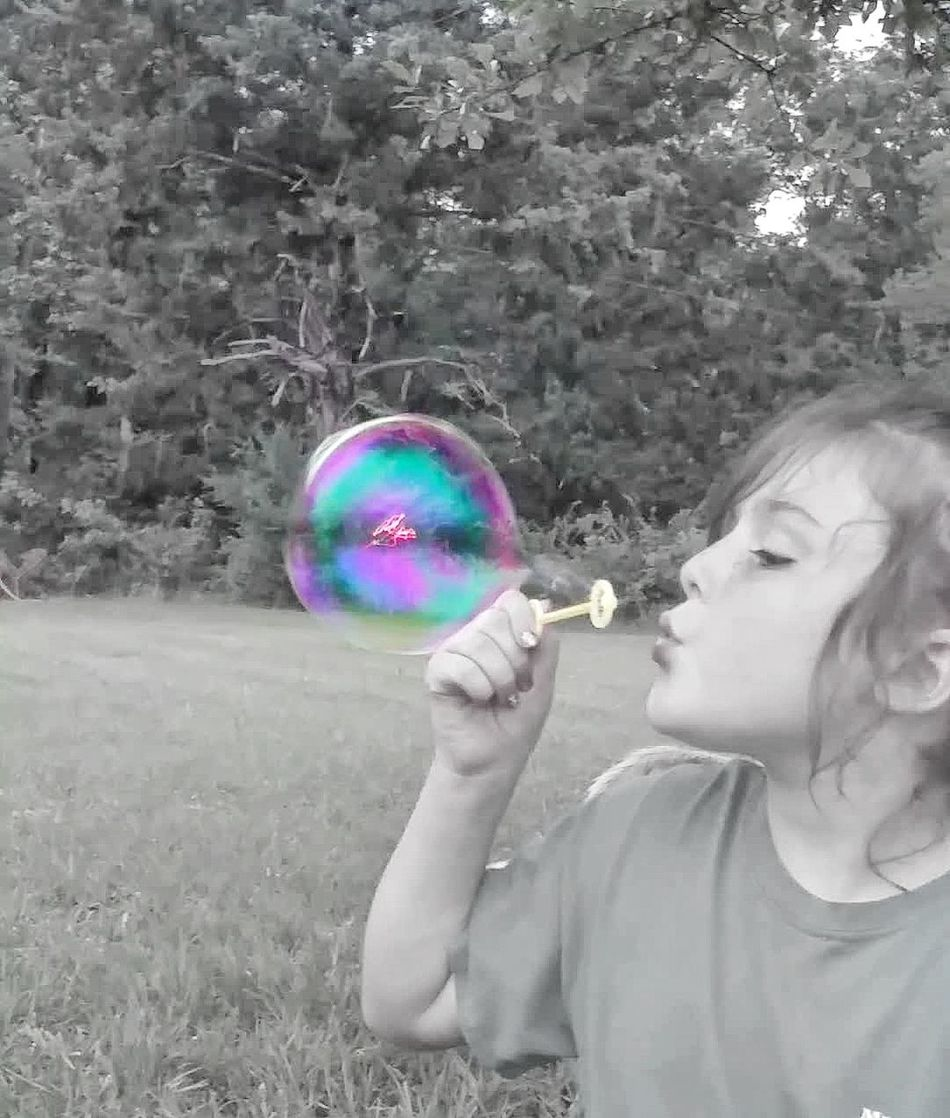 Bubble Fragility One Person People Children Only Front View Child Bubble Wand Futuristic Human Body Part Childhood Outdoors Adult Day Nature Close-up Blowing Bubbles Black And White Selective Color Playing Playing Outside Rainbow Colors Color On Black And White