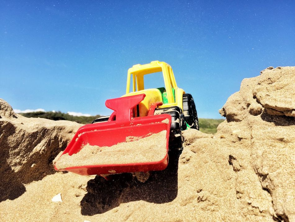 Toy Tractor Sand Dunes Blue Skies Beach Life Playing In The Sand