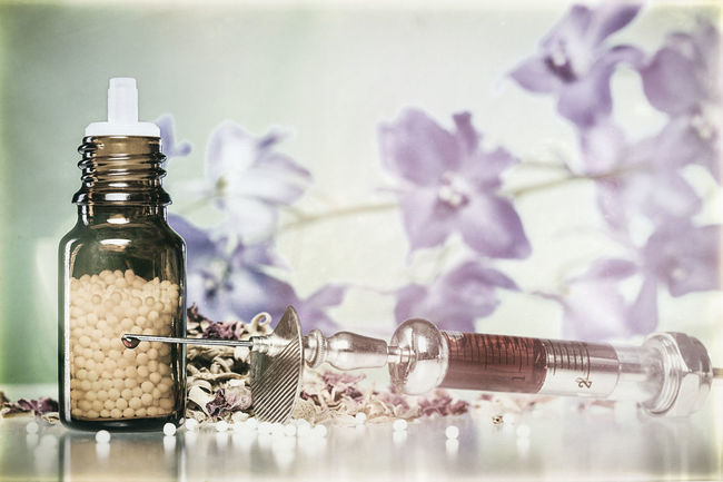 vintage still life with homeopathy globules, syringe with blood and microscope. Bottle Disease Drug Flowers Glass Globules Healing Health Herbal Homeopathy Medical Medicine Nature Pill Still Life Stillife Syringe Therapy