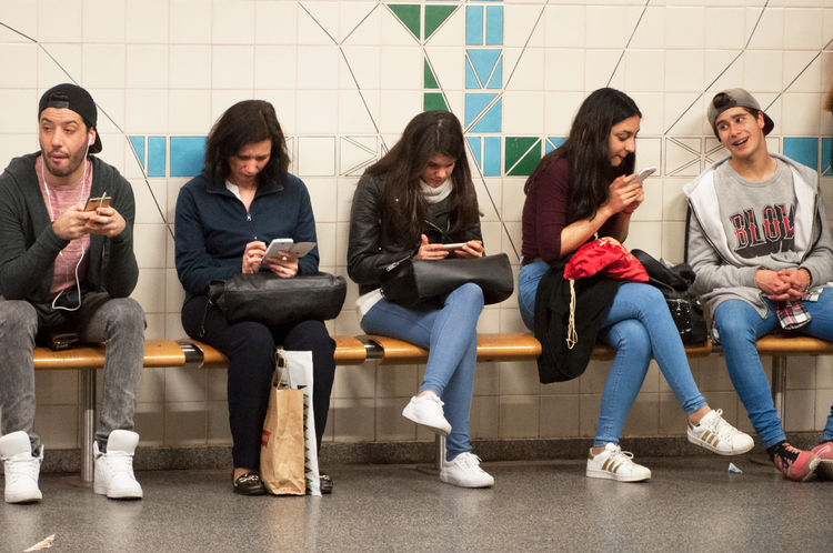 Traveling in the Lisbon Metro Adult Communication Day Friendship Front View Full Length Indoors  Legs Crossed At Knee Looking Down Metro Metropolitanodelisboa People Sitting Technology Togetherness Travelers Traveling Wireless Technology Young Adult Young Women
