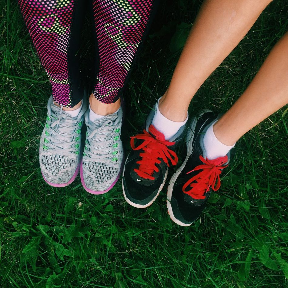 Low Section Person Grass Standing Shoe Footwear Human Foot Togetherness Person Field Outdoors Day Grassy Fashionable Green Color Footpath Running Running Club Nike