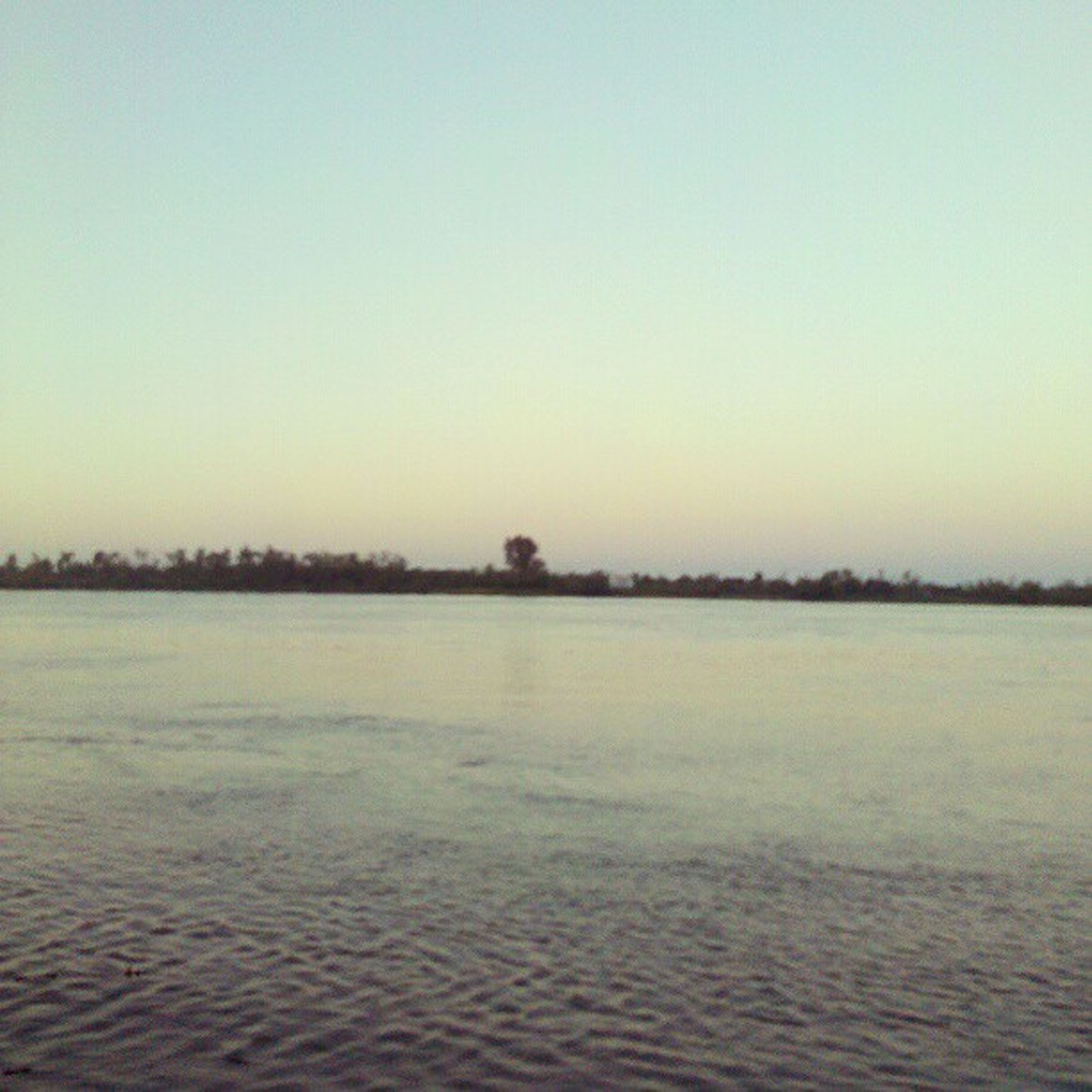 copy space, tranquil scene, clear sky, tranquility, water, scenics, waterfront, beauty in nature, nature, sunset, lake, idyllic, rippled, landscape, outdoors, sea, non-urban scene, calm, no people, mid distance