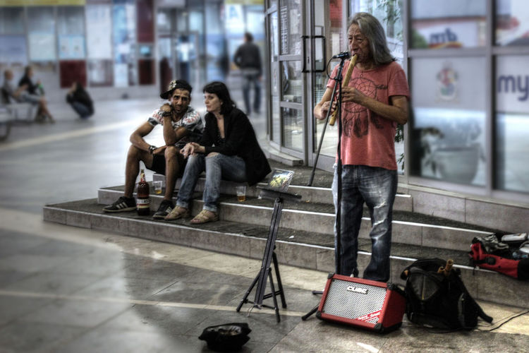 Art Beer Casual Clothing City City Life Day Drinking Experimental Focus On Foreground Leisure Activity Lifestyles Music Musician Photoshop Sitting Street Musician Unreal