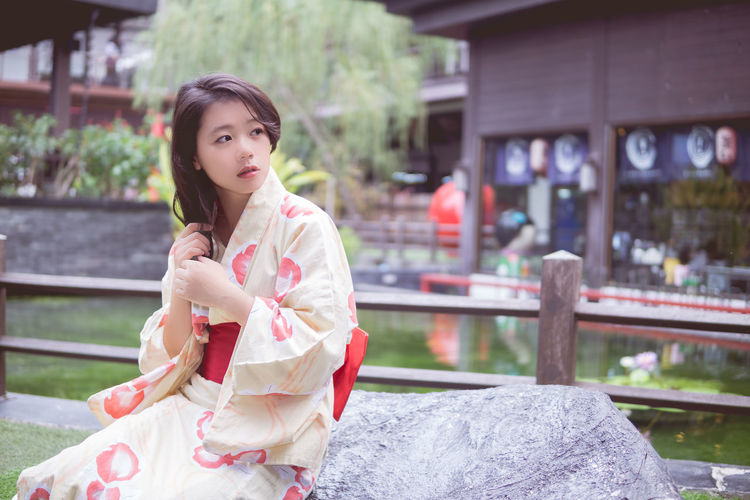 Architecture Beautiful Woman Building Exterior Built Structure Day Focus On Foreground Front View Happiness Kimono Leisure Activity Lifestyles Looking At Camera Nature One Person Outdoors People Portrait Real People Three Quarter Length Young Adult Young Women