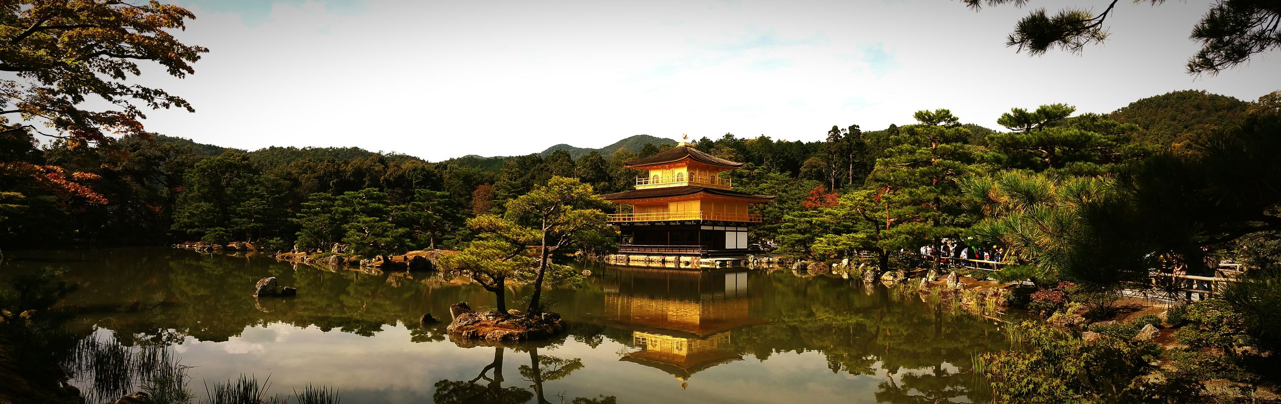 Japanese Holiday beautiful golden pavilion in Japan, said to hold remains of Buddha.