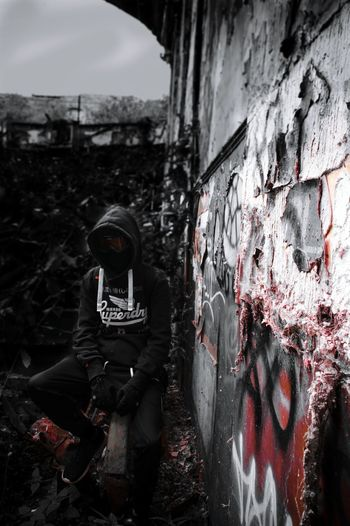 Adults Only Graffiti Abandoned Day Adult People One Person One Man Only Architecture Outdoors Only Men Riot Red Red Color Superdry Superdryhoodie Facecovered Rural Scene Portrait Abbandoned Urbanphotography Abbandoned Place Abbandonedhouse Abbandoned House Burnt Building