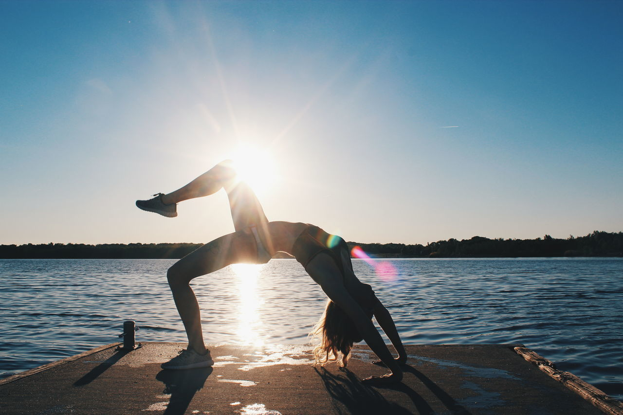 Athleticism Water Sun Lake Exercising Sunlight Sunset Motion Activity Sky Summer Adventure Sport Sea Beach Yoga Girl Yoga Yoga Practice Yogalove Yogalife Yogapose Yogainspiration Yogaeverywhere