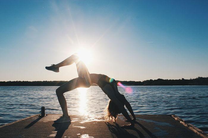 Athleticism Water Sun Lake Exercising Sunlight Sunset Motion Activity Sky Summer Adventure Sport Sea Beach Yoga Girl Yoga Yoga Practice Yogalove Yogalife Yogapose Yogainspiration Yogaeverywhere