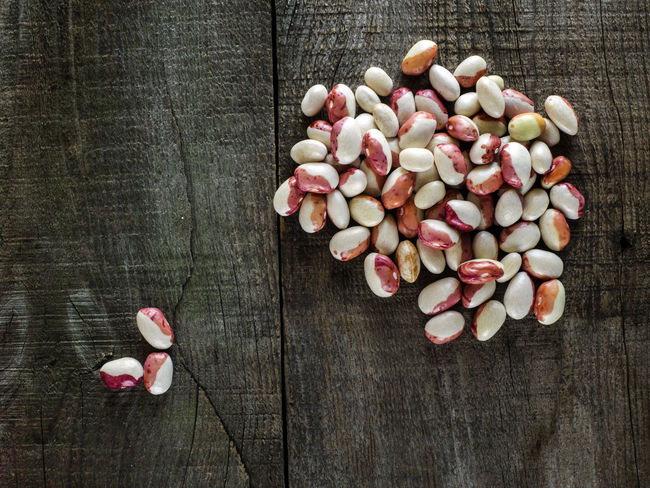 Kidney beans on wood table background. Protein nutrition. Arrangement Beans Brown Close-up Collection Directly Above Fragility Freshness Kidney Large Group Of Objects Medium Group Of Objects Nutrition Pink Color Protein Table Wood Wood - Material Wooden