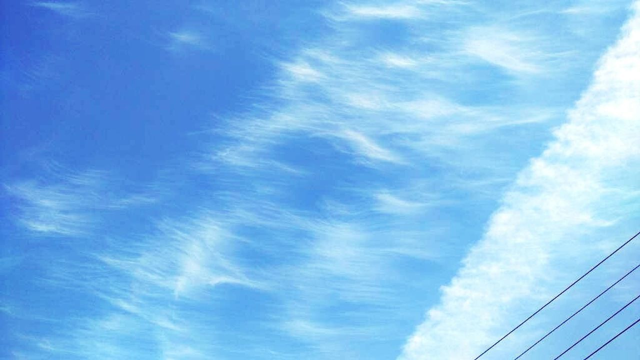 sky, blue, cloud - sky, low angle view, no people, day, wispy, outdoors, backgrounds, nature, scenics, beauty in nature, vapor trail