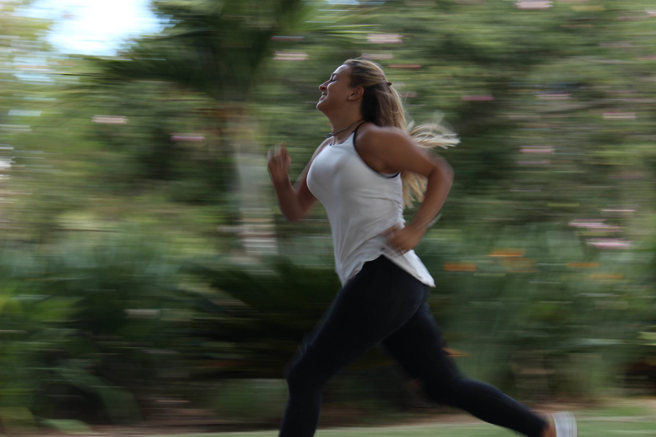 blurred motion, motion, real people, lifestyles, running, speed, one person, young adult, young women, leisure activity, healthy lifestyle, day, outdoors, exercising, nature, tree, water