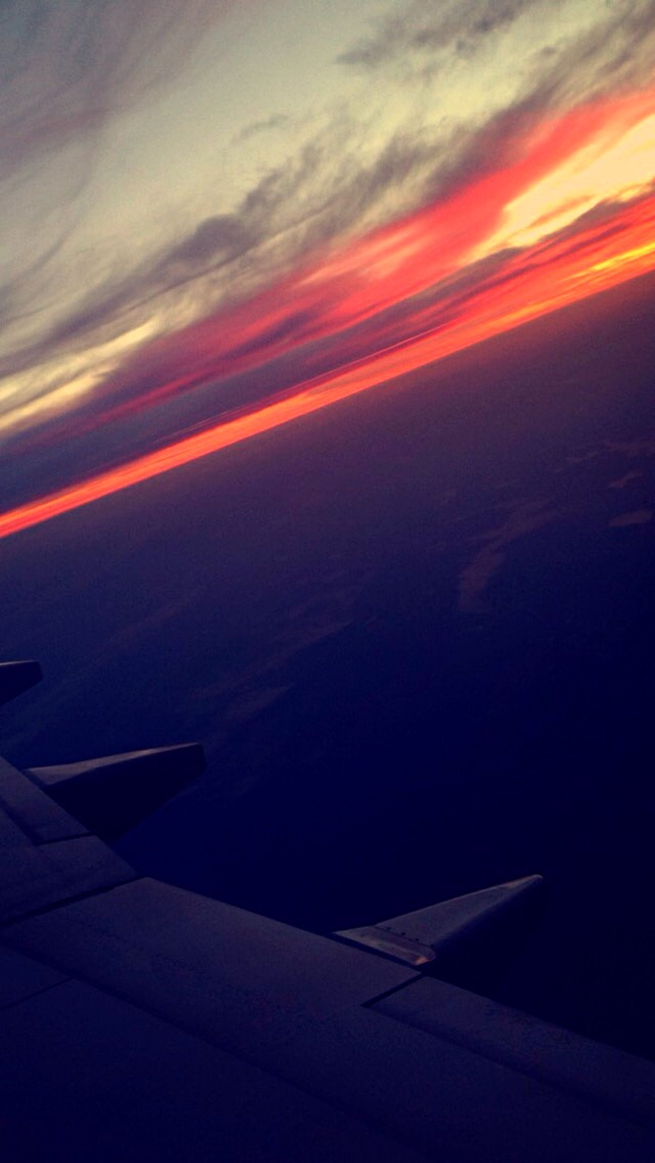 sunset, sky, orange color, airplane, cloud - sky, scenics, transportation, beauty in nature, air vehicle, dramatic sky, aerial view, nature, aircraft wing, flying, no people, cloud, outdoors, mode of transport, tranquility, idyllic