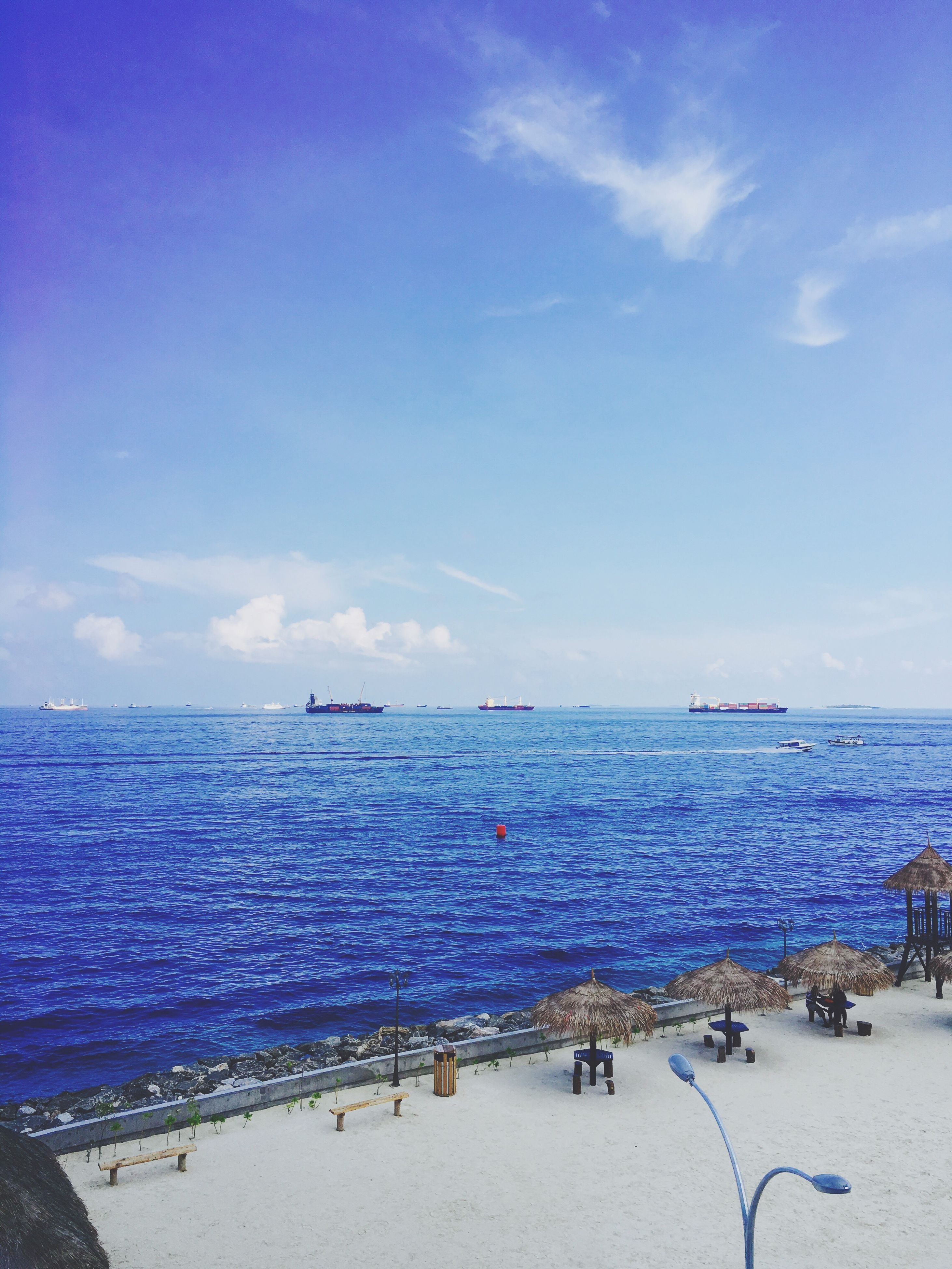sea, beach, water, horizon over water, blue, shore, sky, large group of people, sand, vacations, scenics, nautical vessel, transportation, beauty in nature, tranquil scene, nature, tranquility, travel, incidental people