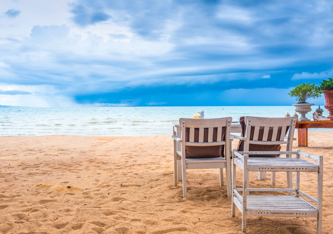 beach, sand, sky, sea, cloud - sky, chair, horizon over water, shore, water, nature, day, absence, no people, outdoors, tranquil scene, tranquility, beauty in nature, scenics, sunlight, seat