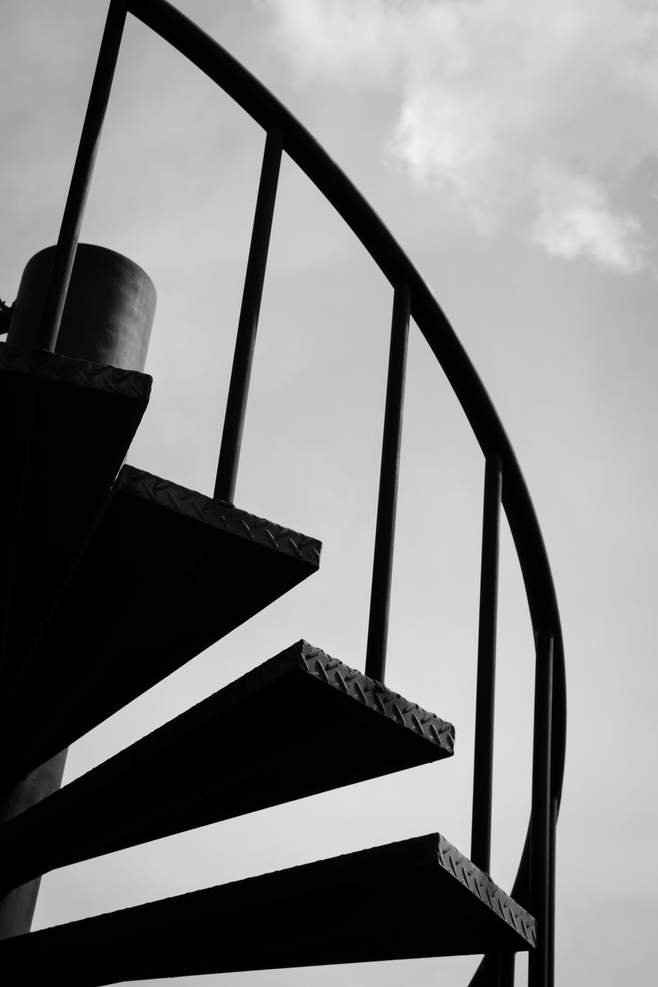 Spiral staircase Low Angle View Architecture Built Structure No People Staircase Building Exterior Outdoors Blackandwhite Blackandwhite Photography Metallic Lines And Shapes Modern Architecture Design Black Structure Railing Ladder Up Silhouette Elegant