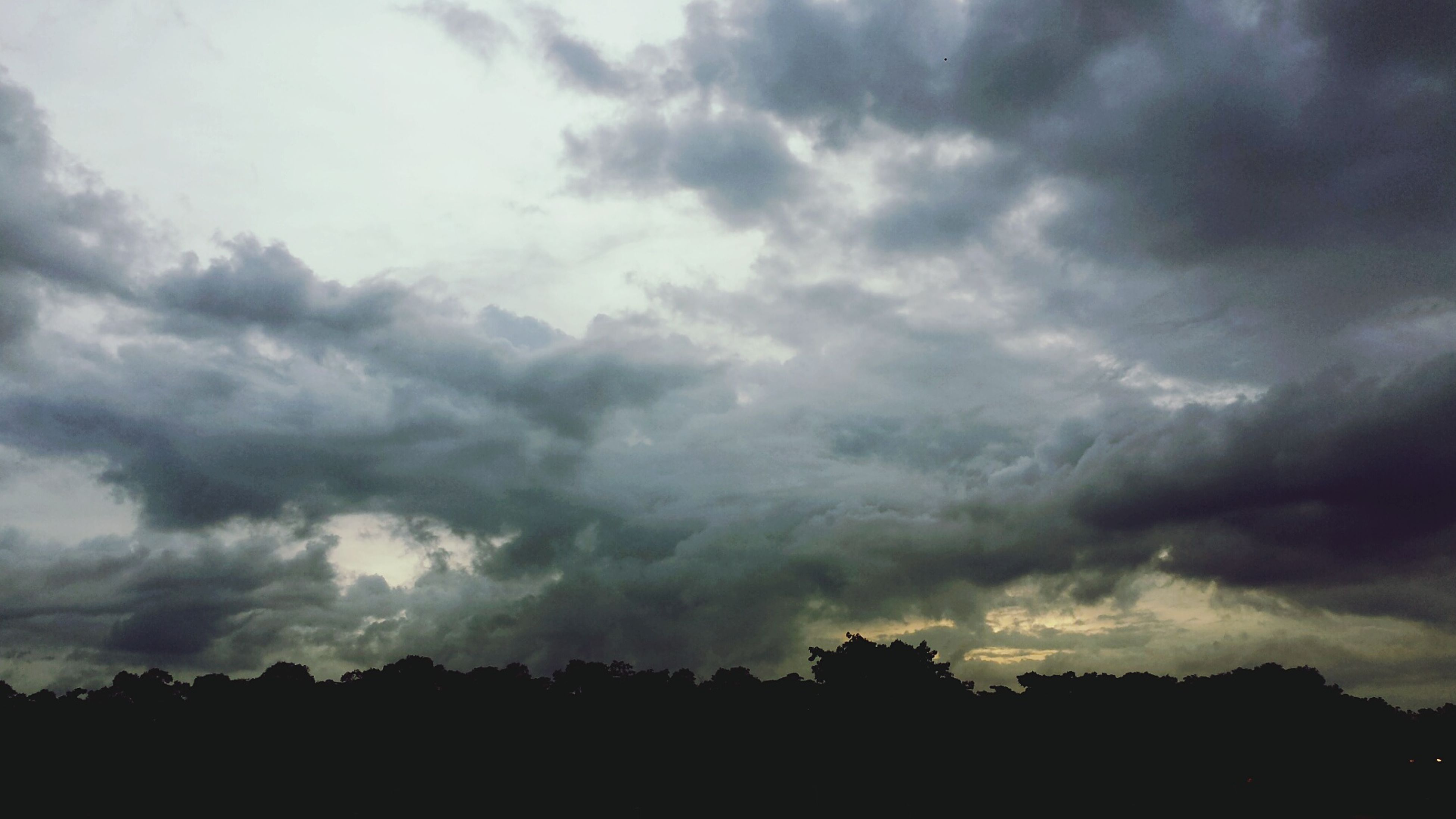 sky, cloud - sky, cloudy, silhouette, weather, overcast, storm cloud, scenics, beauty in nature, tranquility, tranquil scene, low angle view, nature, cloudscape, cloud, dusk, dramatic sky, atmospheric mood, outdoors, idyllic