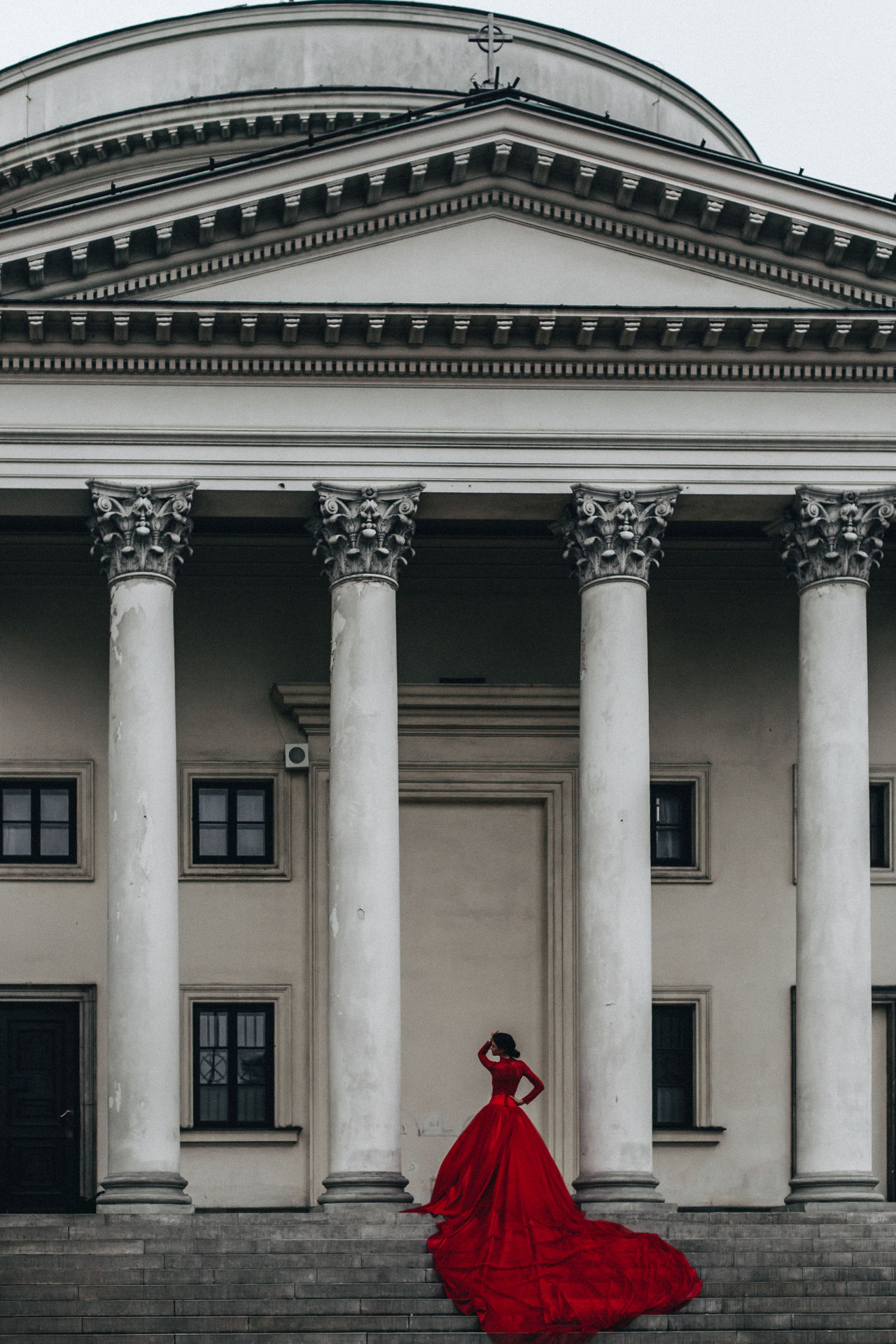 Lady in Red Architectural Column Architecture Building Exterior Built Structure City Lifestyles One Person Outdoors Real People Red Red Dress Women