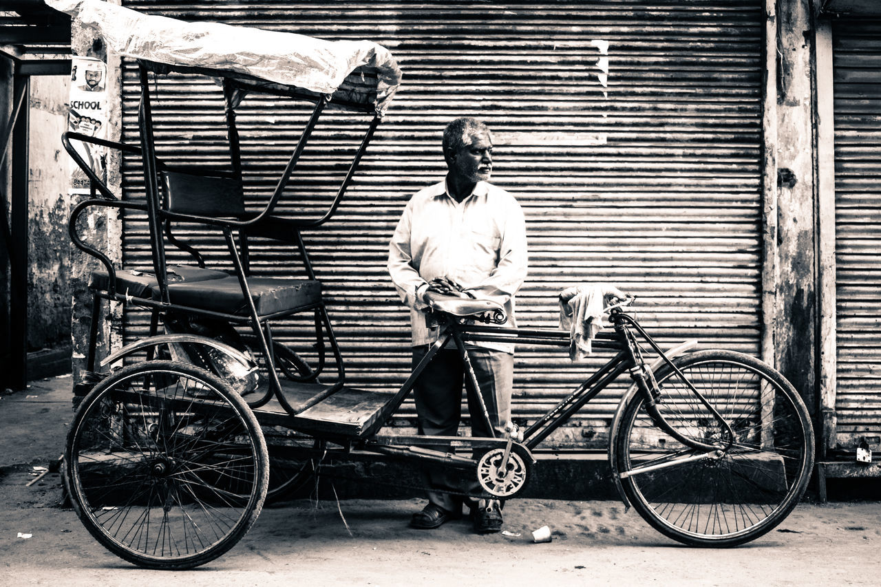 Bicycle Transportation One Person Mode Of Transport Full Length Outdoors Day City Land Vehicle Building Exterior Adults Only One Man Only Adult Real People Men People Only Men Rikshaw Old Delhi Streeetphotography Storytelling Awesome_view Delhi Carnival Crowds And Details Monument