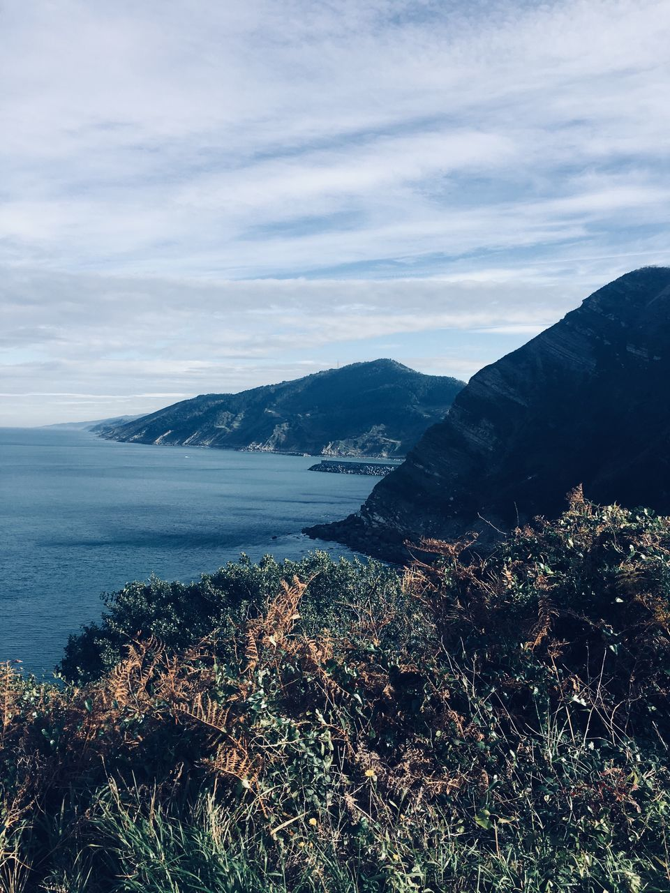 nature, mountain, beauty in nature, scenics, water, sea, tranquil scene, tranquility, outdoors, no people, sky, day, landscape, scenery