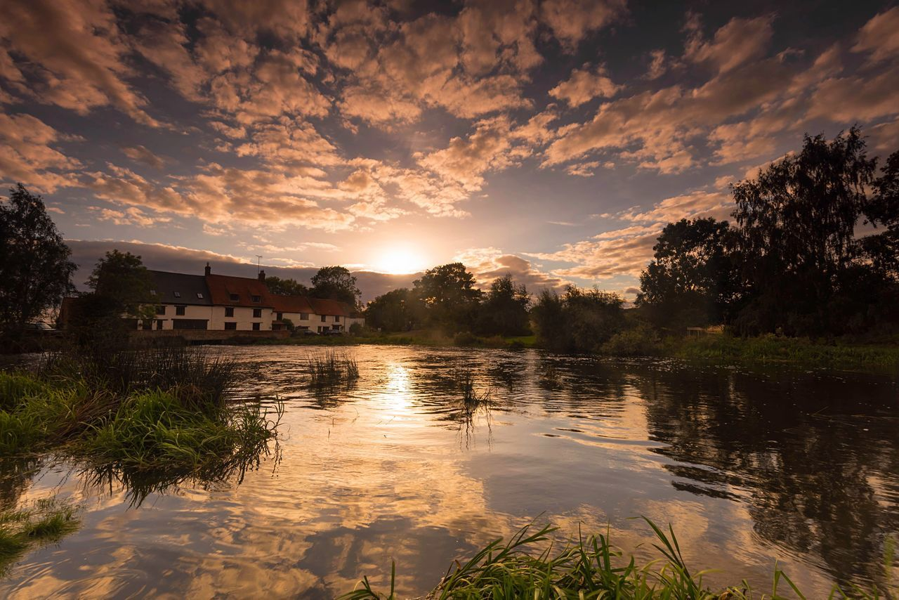 Reflecting Reflection Water Cloud - Sky Tree House Sky Outdoors Sunset Building Exterior Tranquility Landscape Extreme Weather No People Lake Scenics Nature Day Architecture The Great Outdoors - 2017 EyeEm Awards The Architect - 2017 EyeEm Awards Watermill Countryside British Countryside Sunset Reflection Rippled