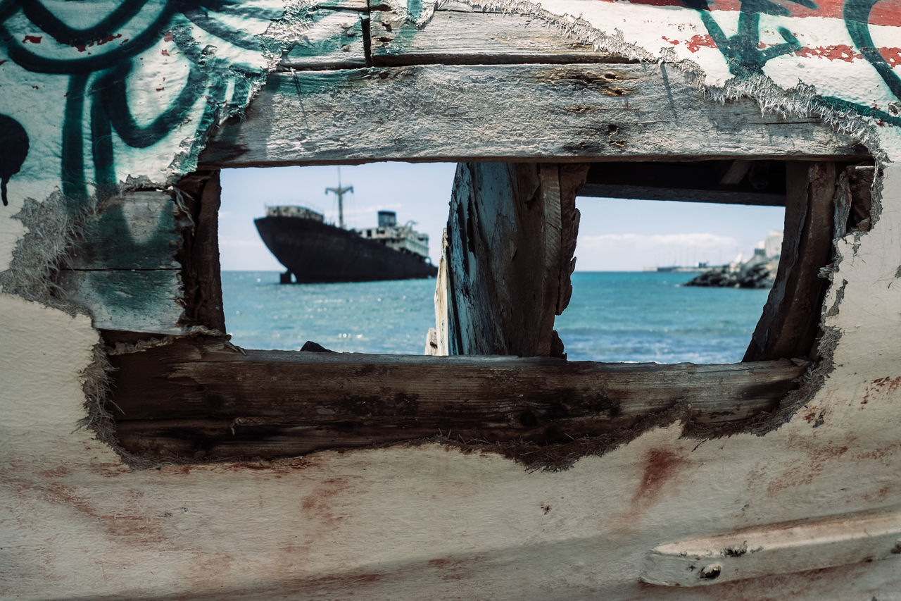 A broken fisherman boat in foreground with the Telamon-wreck in the distance Beach Beauty In Nature Built Structure Day Nature Nautical Vessel No People Outdoors Sea Ship Shipwreck Sky Water Wood - Material Wreck